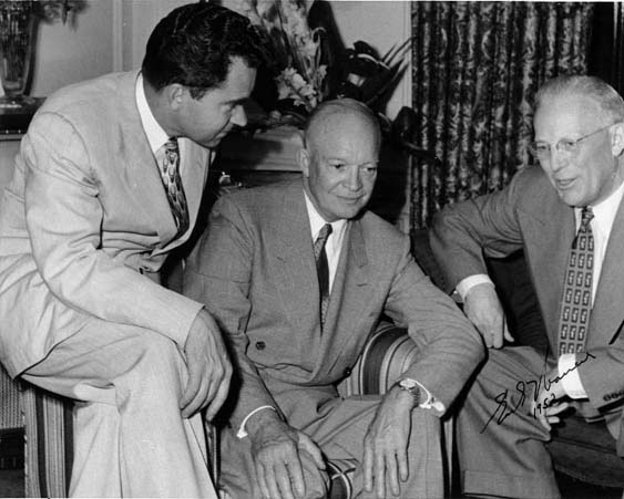This black and white photograph of Governor Earl Warren with Dwight D. Eisenhower and Richard M. Nixon was taken in 1952. The image shows the three men sitting together and having a casual conversation.