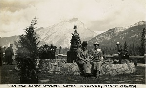 96-07-08-alb10-184, William and Grace McCarthy sitting near a fountain on the grounds of the Banff Springs Hotel, Canada, c. 1935