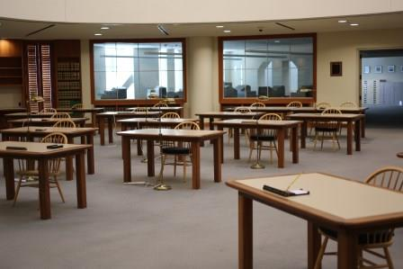 Photograph of the Research Room at the California State Archives. Shows several rows of tables and chairs.