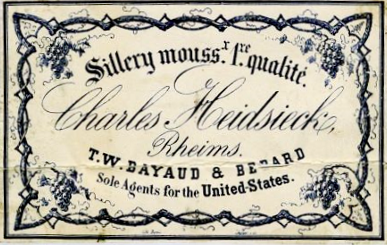 A very fancy trademark with numerous different lettering styles. The lettering is dark blue, perhaps purple, on an off-white background. The words Sillery Mouss.x 1xe. qualite appear arched over the name Charles Heidsieck, Reims. Below reads, T.W. Bayaud and Berard, sole agents for the United States. Around the edge of the label appears some fancy filigree with bunches of grapes at each corner.