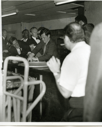 Black and  white photo of the struggle to take gun from Sirhan Sirhan in the Ambassador Hotel Pantry